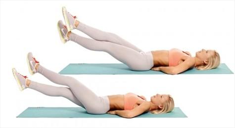 Bài tập giảm mỡ bụng Nằm đá chéo chân